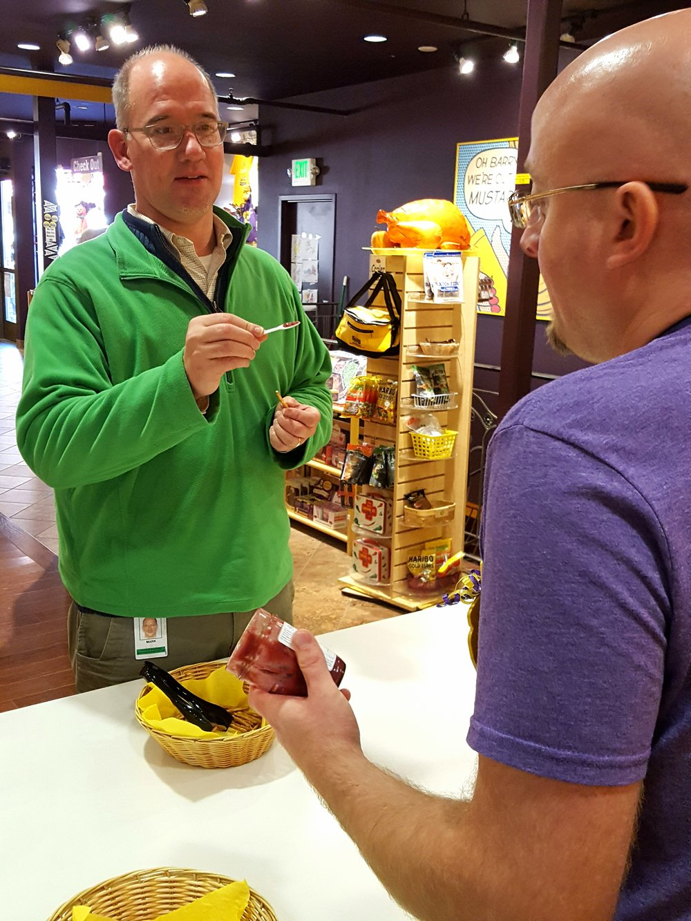 Customer Mark Werner tries out a variety of mustards.