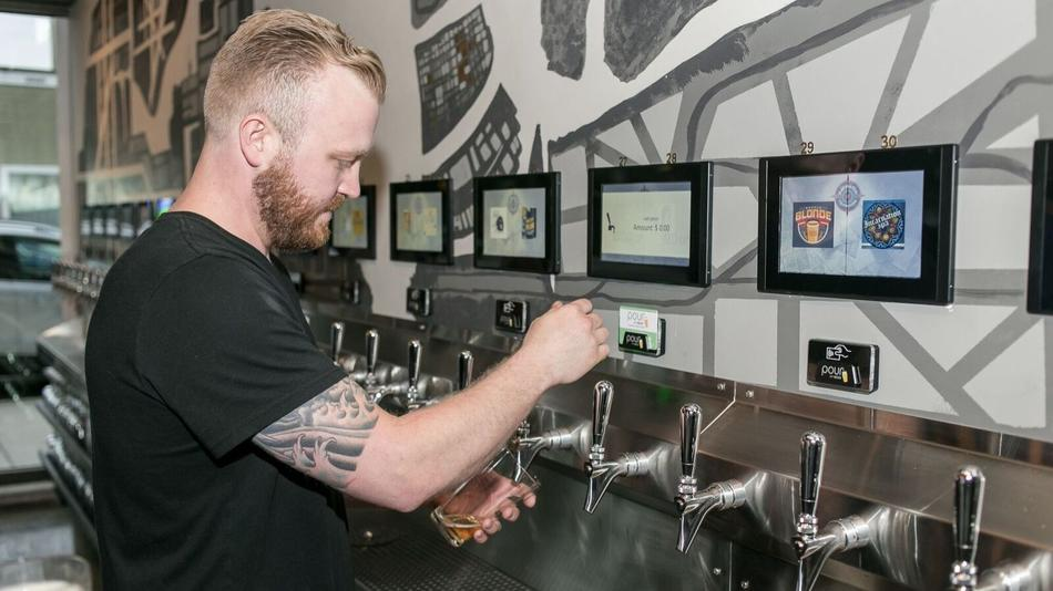 Navigator Taproom co-owner Erik Swanson pours a beer. (Dev Photography / Handout)