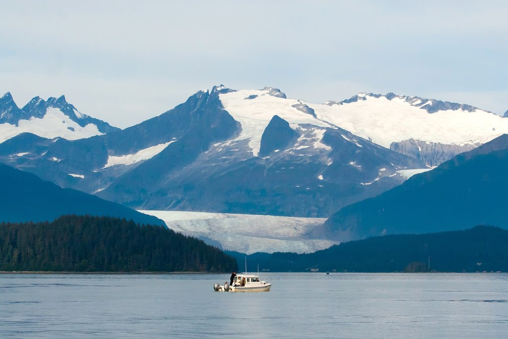 Lone boat on bay in Alaska. .