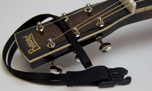 2) Slip loop between upper sets of tuners and under strings.