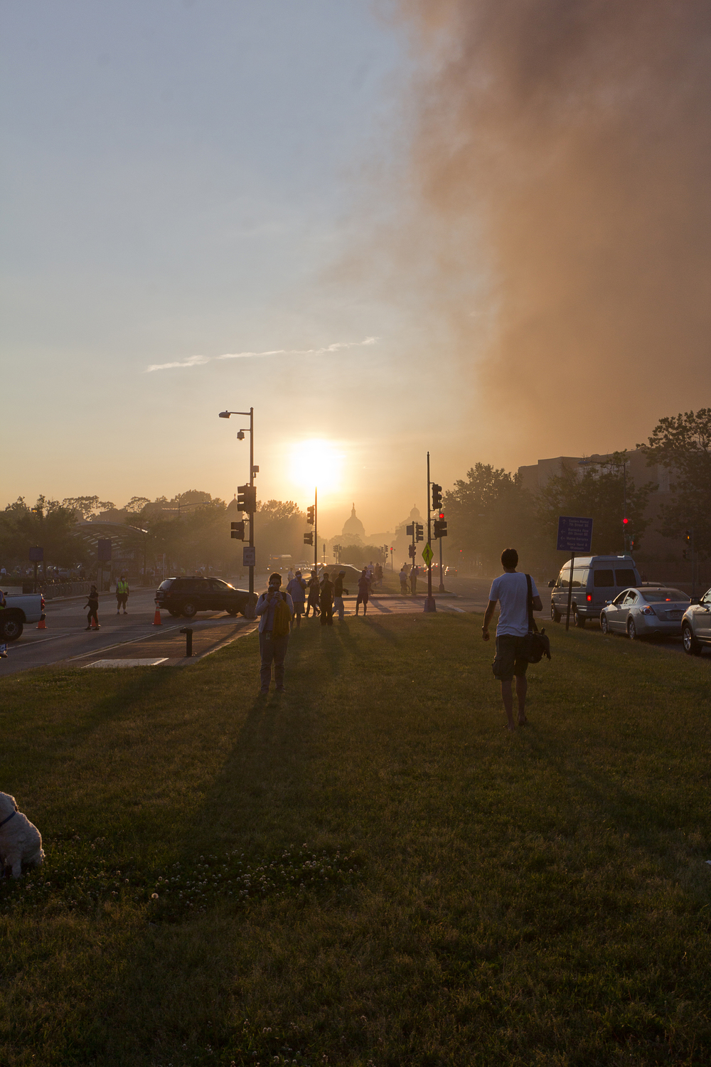 As the wind started to shift, the smoke began to clear away from Pennsylvania Avenue and disperse higher up in the air.