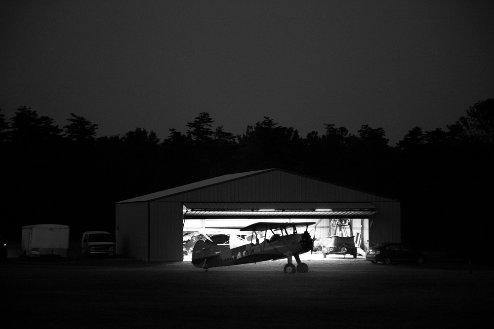 The first Boeing Stearman out of the hangar being prepped for the days events just before dawn