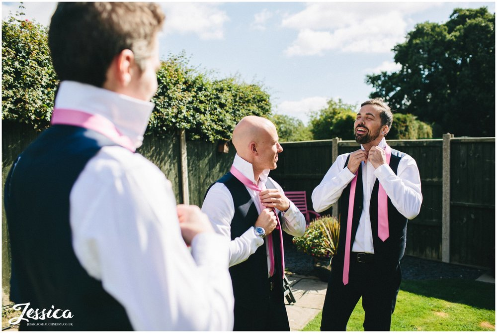 groomsmen fasten ties ahead of the wedding ceremony - north wales wedding