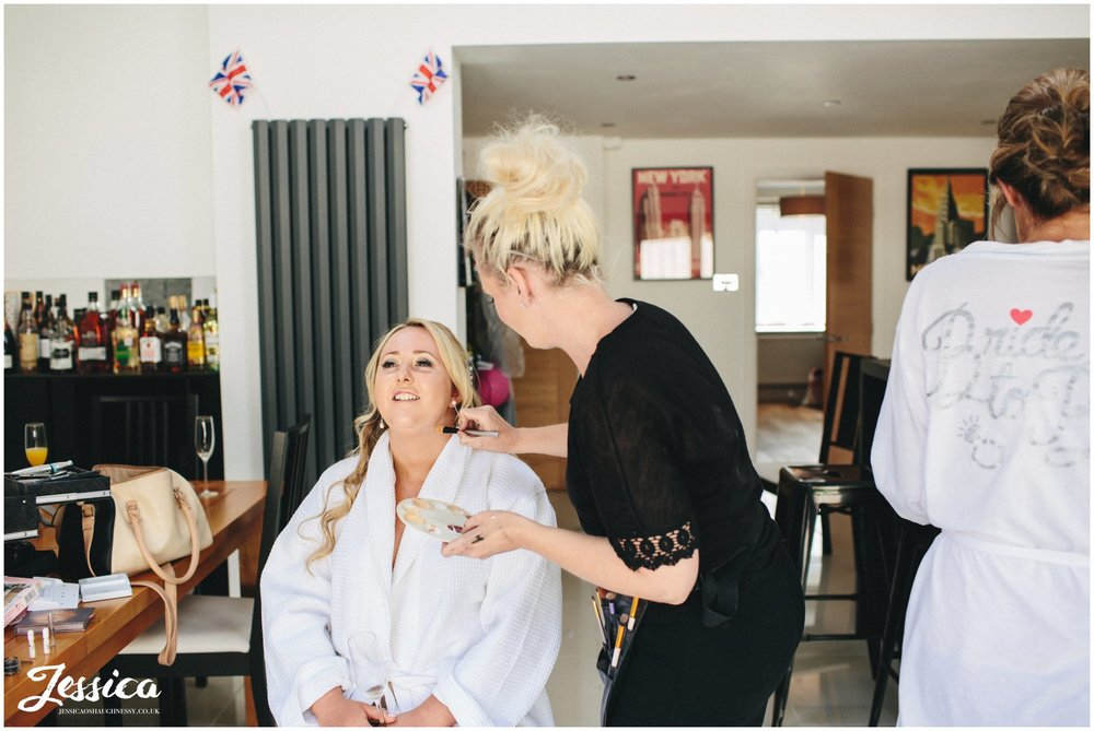 bridesmaid having her make up done at the brides house in north wales