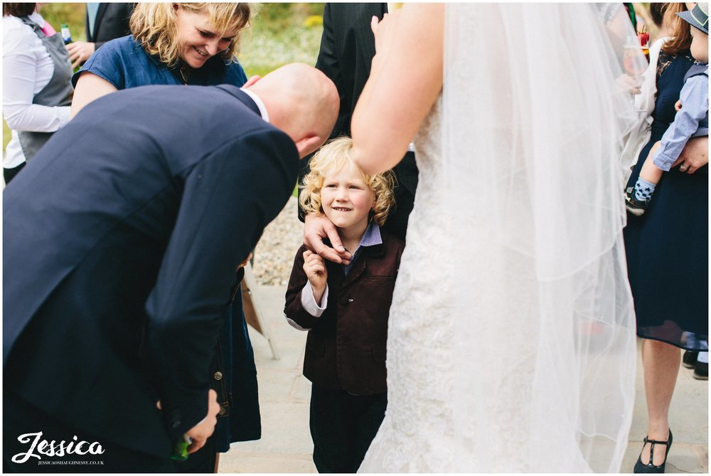 child speaks to the groom on his wedding day in wrexham