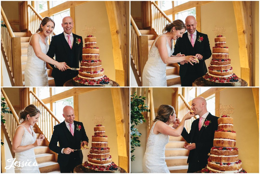bride & groom cutting their cake on their wedding day