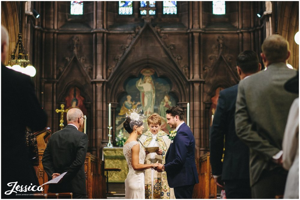 Bride & Groom saying vows at their wedding in Chester Church