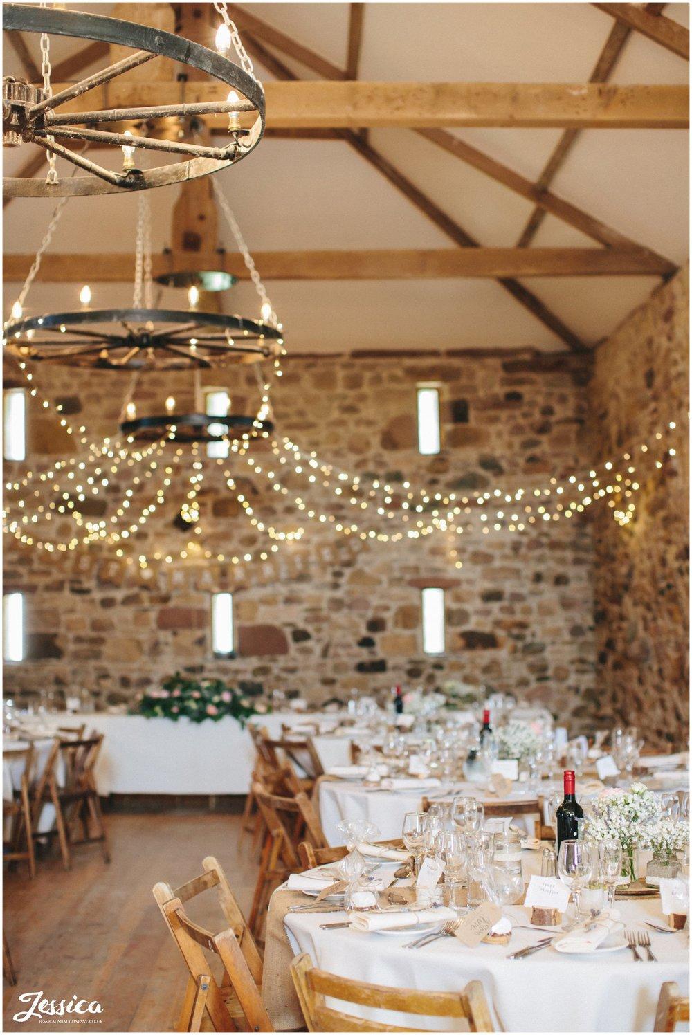 Barn dressed in rustic wedding decorations, cumbria wedding photographer