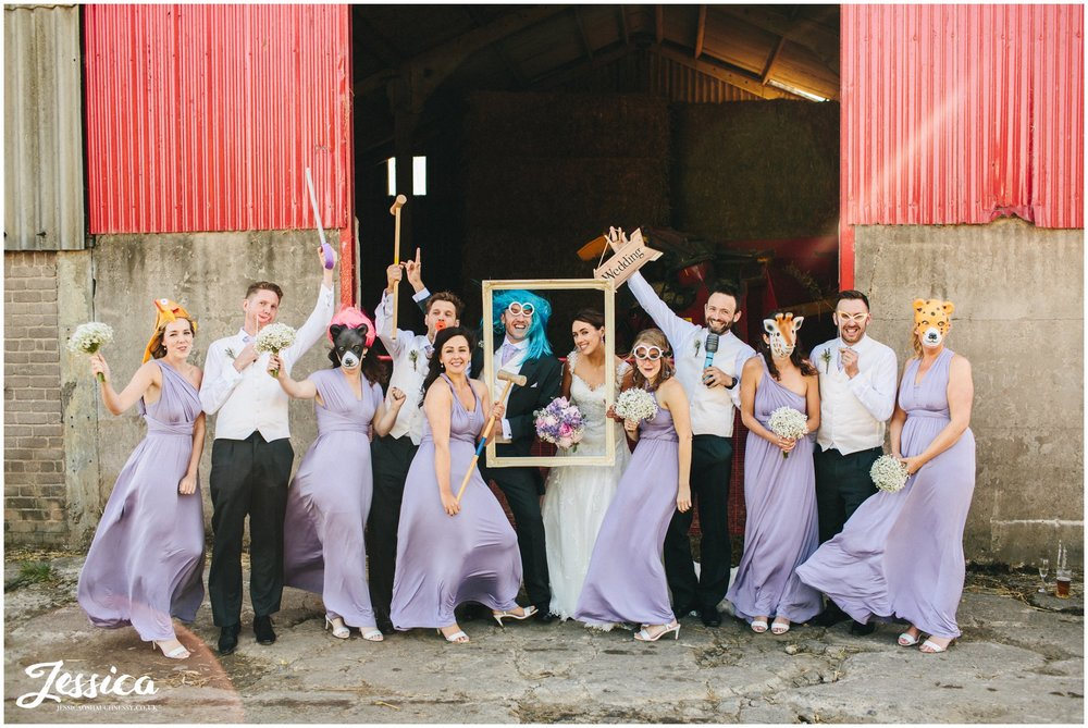 guests pose with props infront of farm gate at Three Hills Barn, Torpenhow