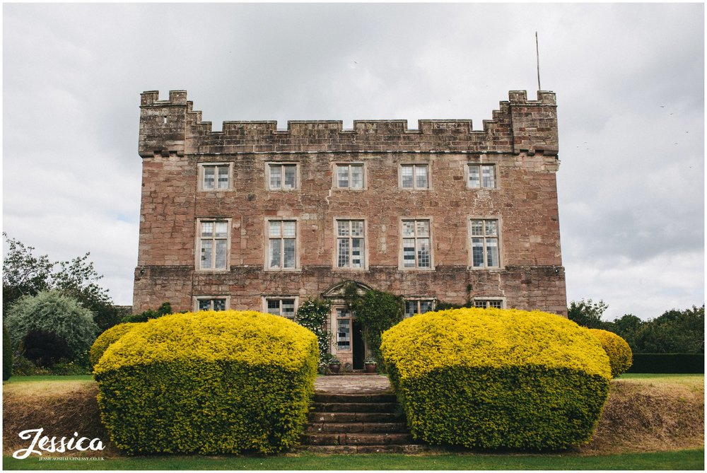 Shot of Askham Hall taken from the front lawn - lake district wedding photographer