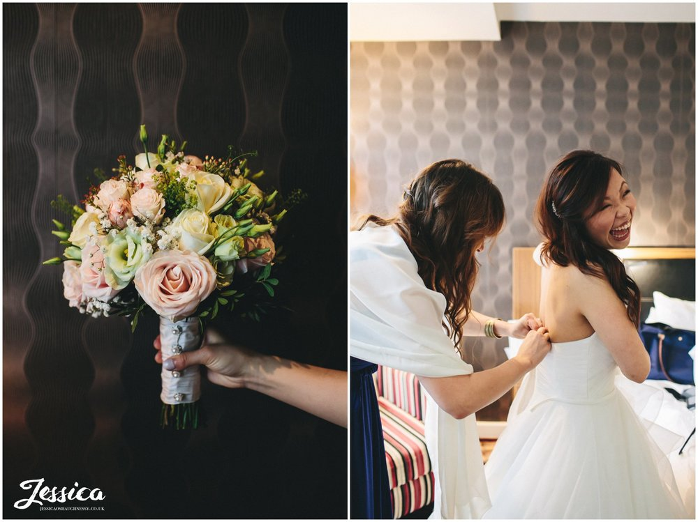bouquet & bride getting into her wedding dress ready for the ceremony at On The 7th