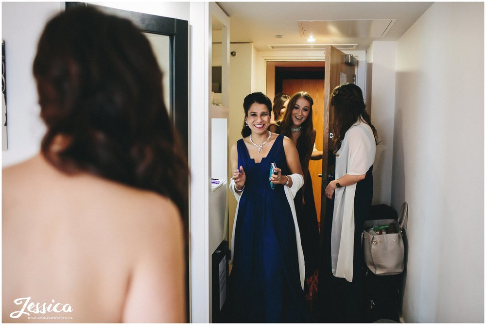 bridemaids see the bride in her dress for the first time - manchester wedding photographer