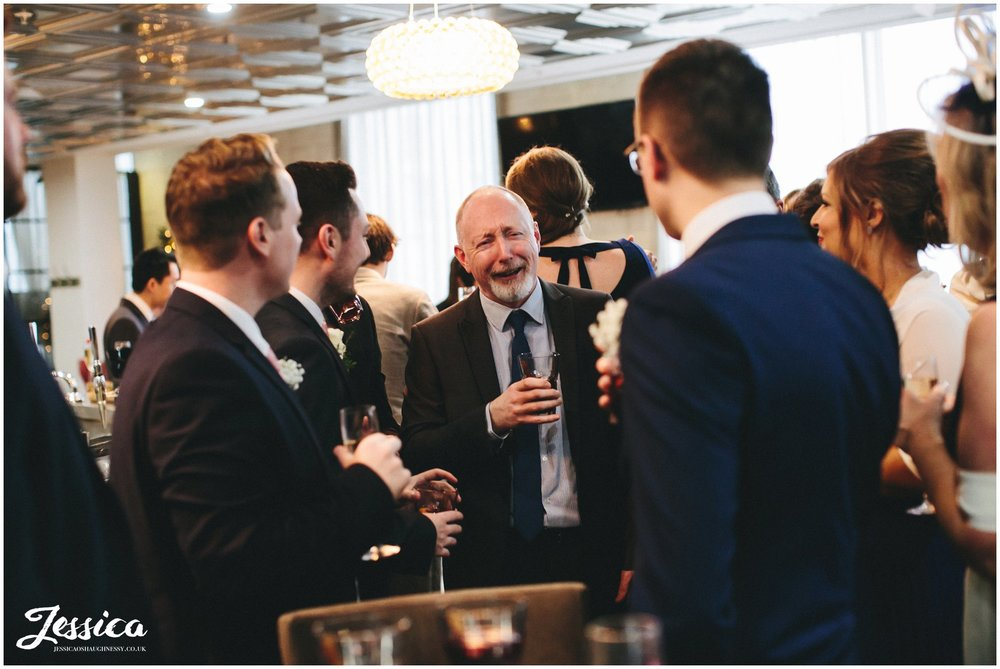 guests laughing & celebrating the marriage at on the 7th, manchester