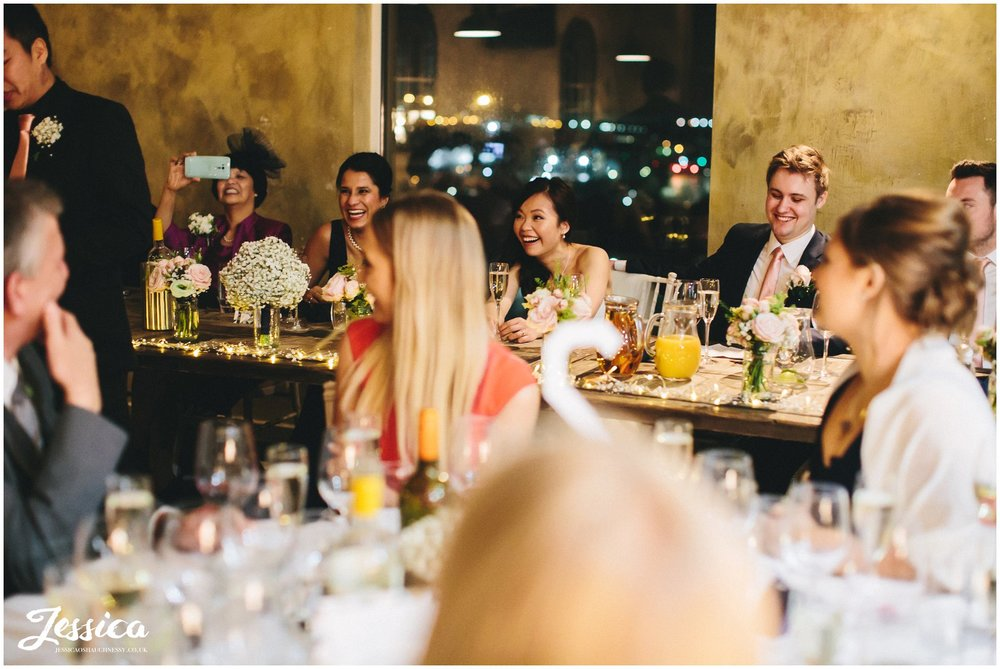 top table laughing during the wedding speeches at on the 7th