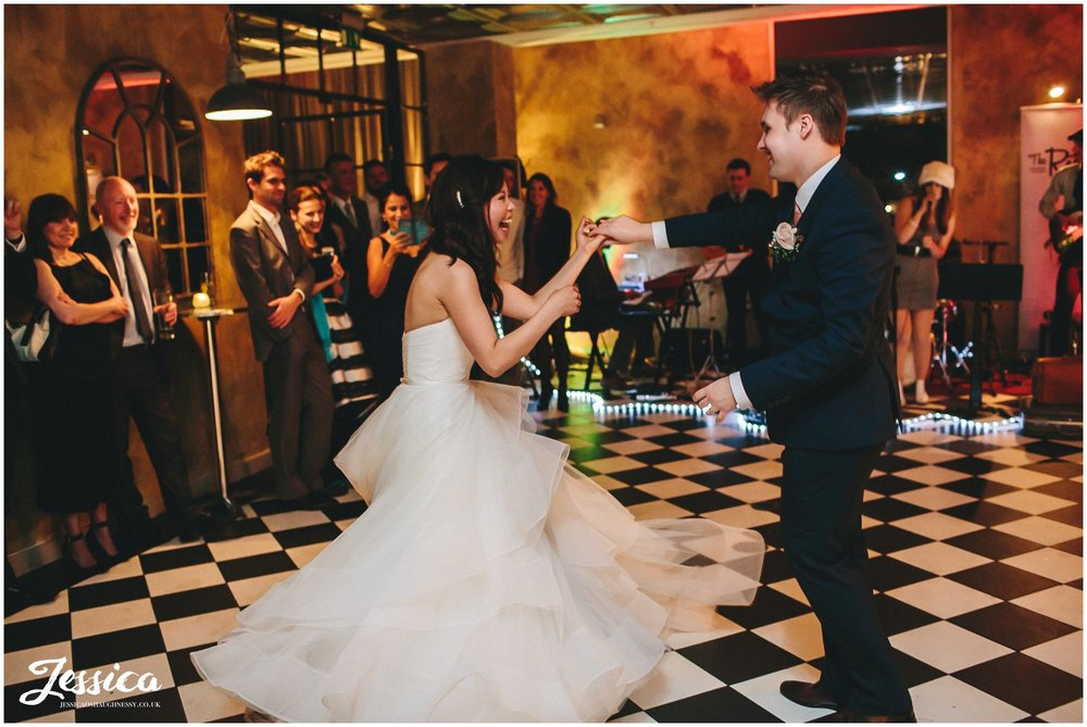 newly wed's dancing during their wedding reception in manchester