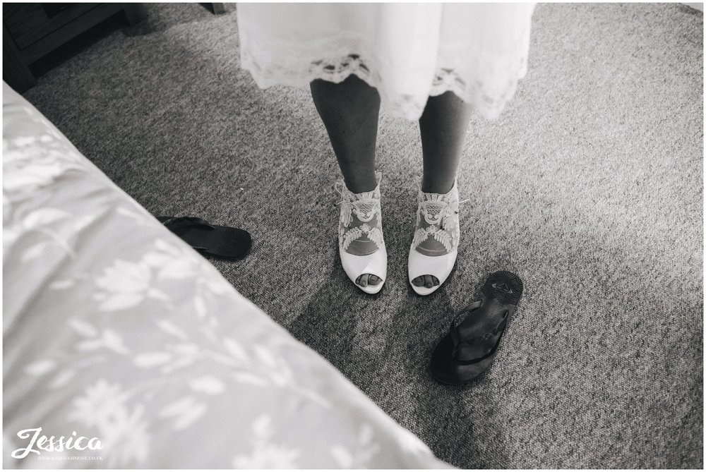 close up of brides shoes in black and white - north wales wedding wedding photographer