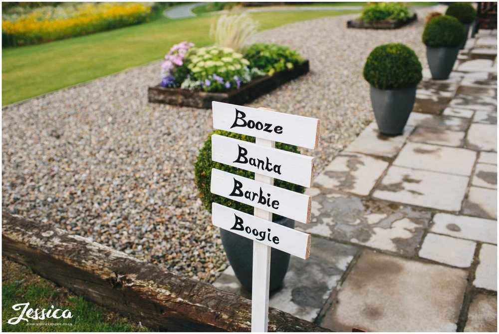 sign saying booze, banta, barbie & boogie at a tower hill barns wedding
