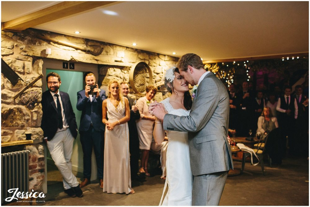 north wales wedding photographer - bride & groom share first dance at tower hill barns