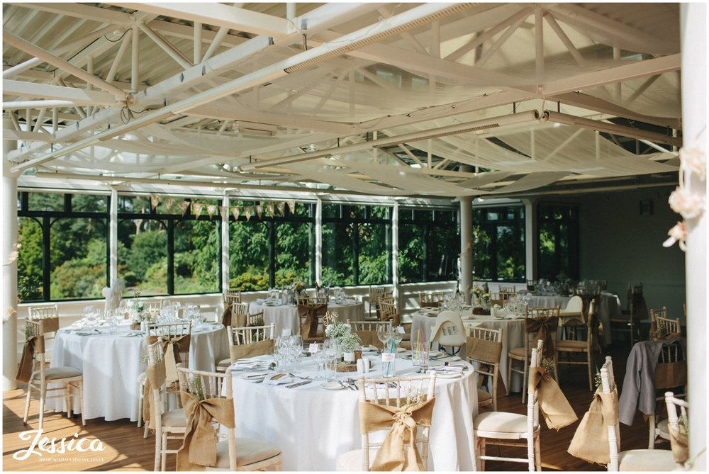 wedding breakfast room laid out in rustic decorations for a wedding at ness gardens