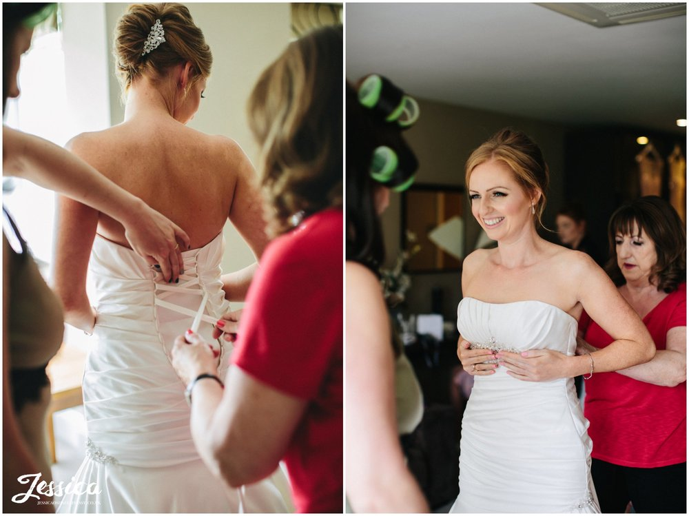 bride gets changed into her wedding dress at her wirral wedding