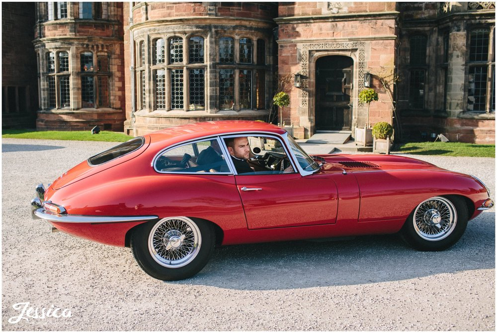 Groom pulls up to his wedding on the wirral in an e type jag