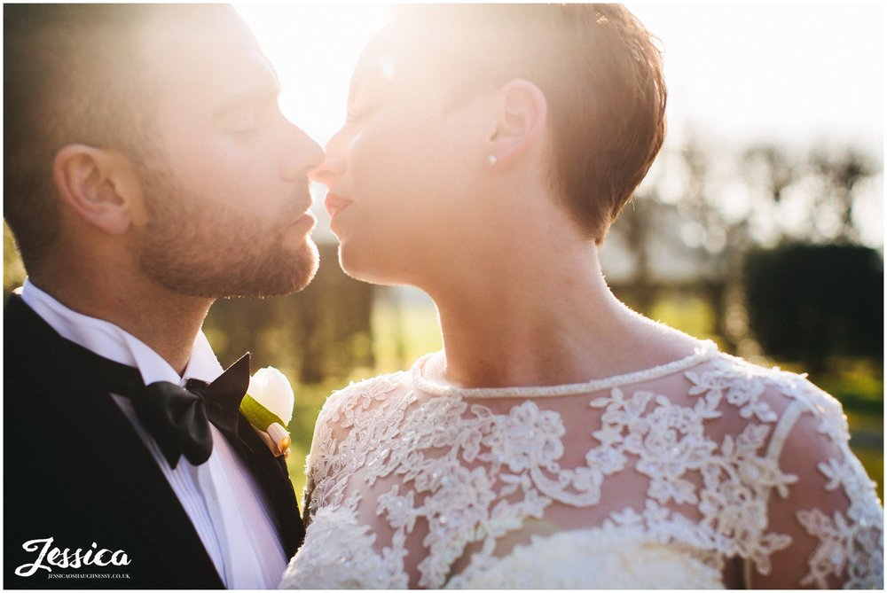 close up of couple kissing in the evening sun - thornton manor wedding on the wirral