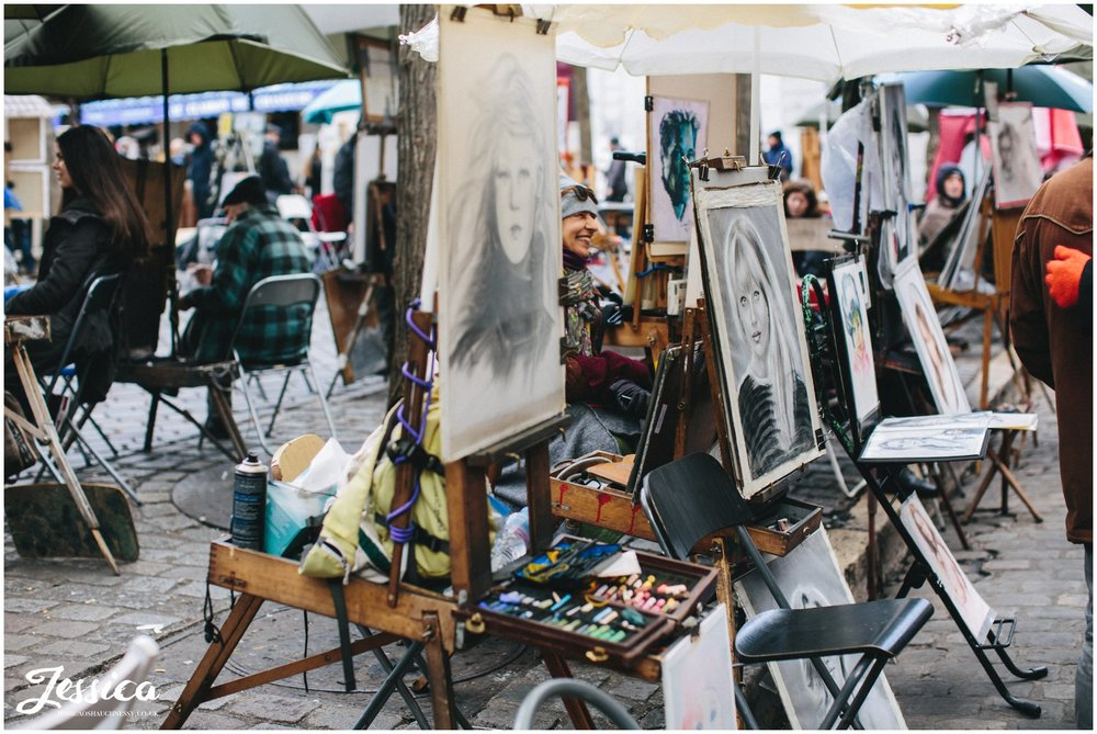 artists paint in the square in mont marte, paris