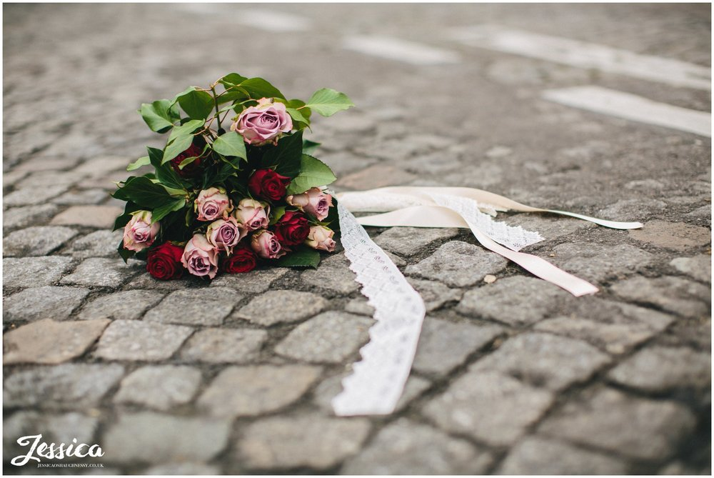 bridal bouquet lying on the a road in mont marte, paris