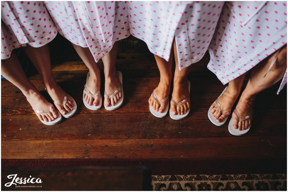 bridesmaids wearing their wedding day flip flops
