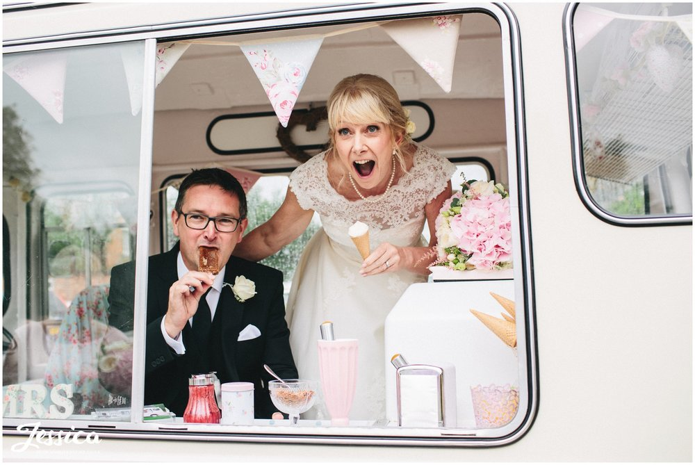 bride & groom eating ice-creams inside a vintage ice-cream van at their cholmondeley arms wedding