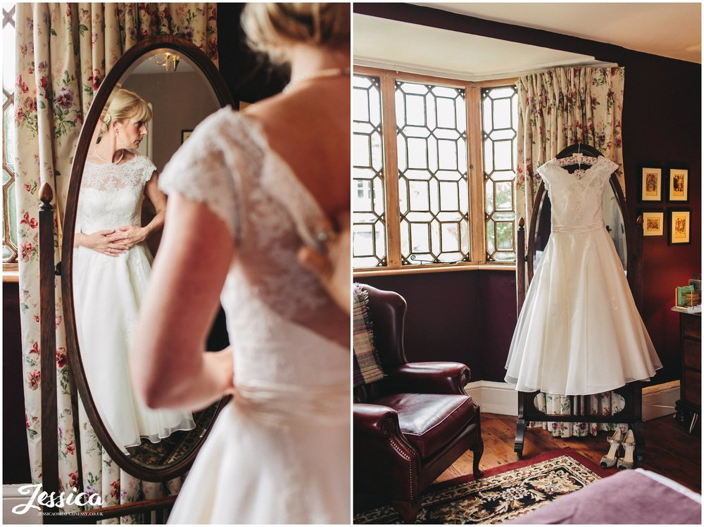 bride getting into her tea-length dress at her cholmondeley arms wedding