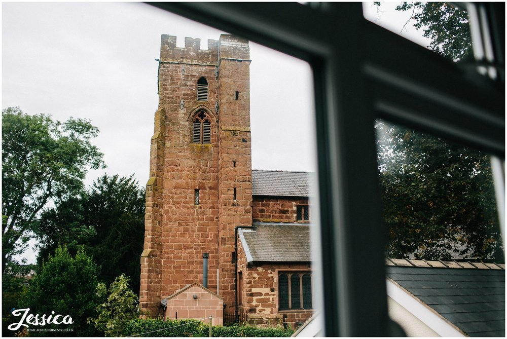 view of st chad's church in farndon taken from the bride's bedroom