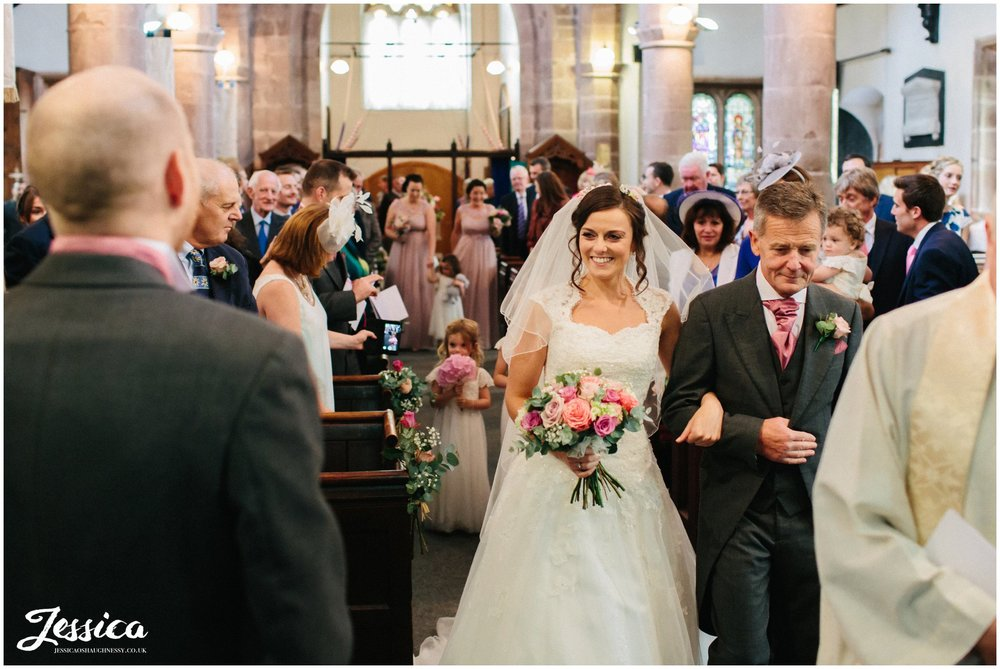 bride see's her groom for the first time on their wedding day in cheshire