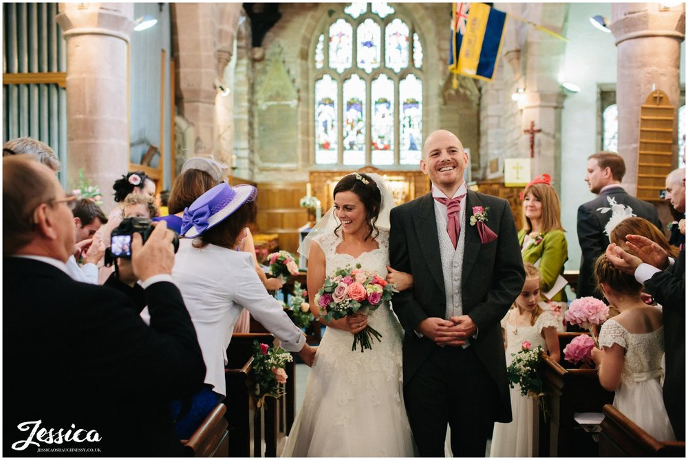newly wed's exit church after their wedding ceremony in cheshire