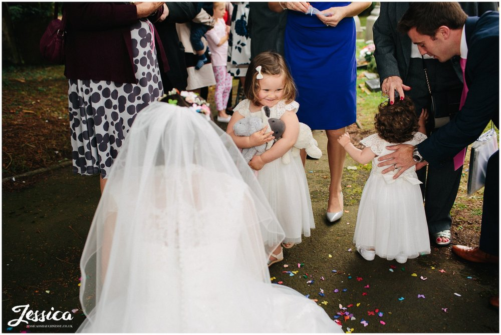 bride talking to her flower girls after the wedding ceremony