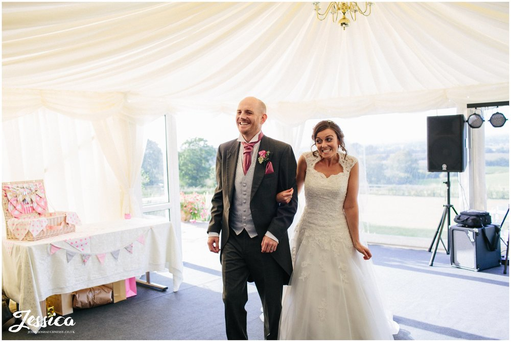 bride & groom are announced into their wedding breakfast at harthill weddings, cheshire