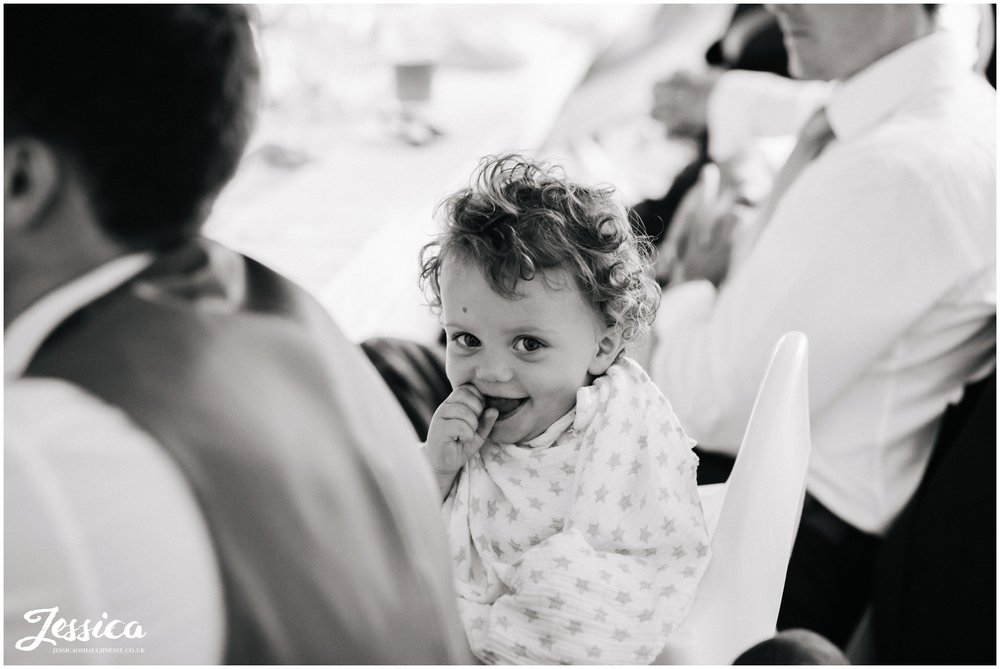 child laughing during the speeches at harthill weddings