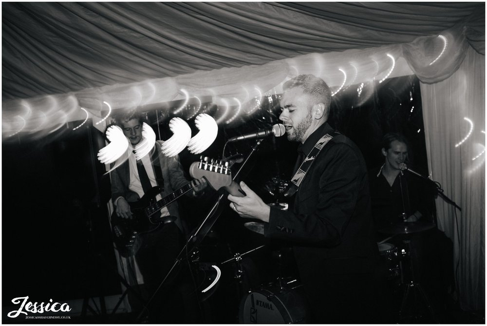 black and white band preforming during wedding reception at the success factory, cheshire