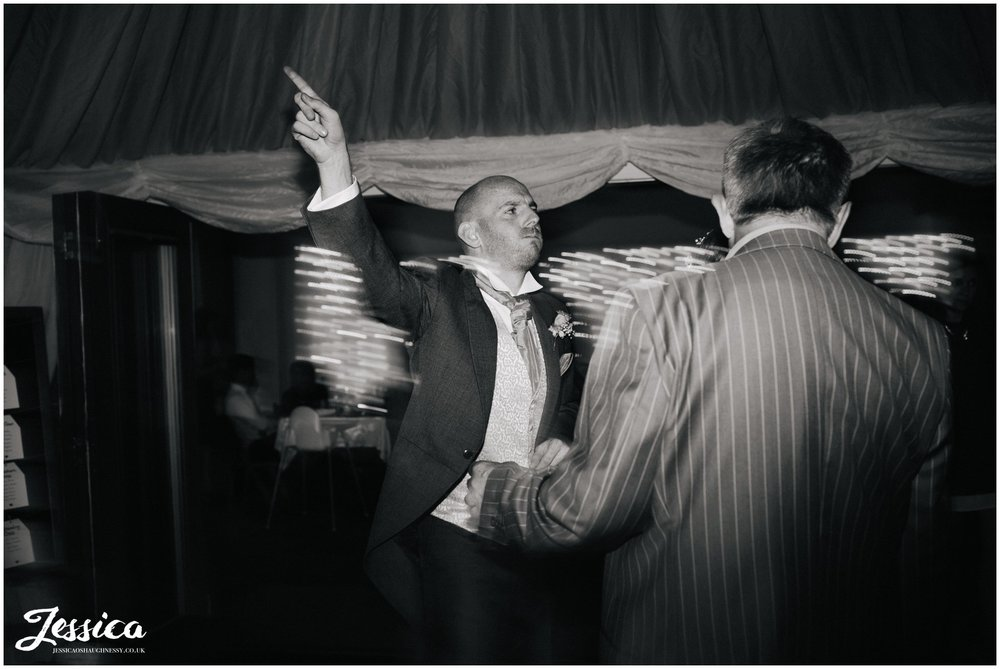 groom dancing at his wedding at harthill weddings, cheshire