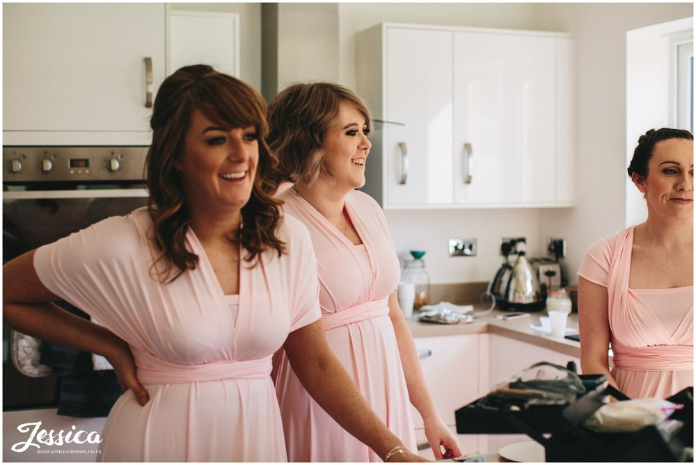 bridesmaids laugh as they get ready for a north wales wedding