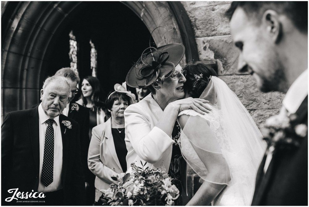mother of the bride hugs her daughter after her wedding ceremony in north wales