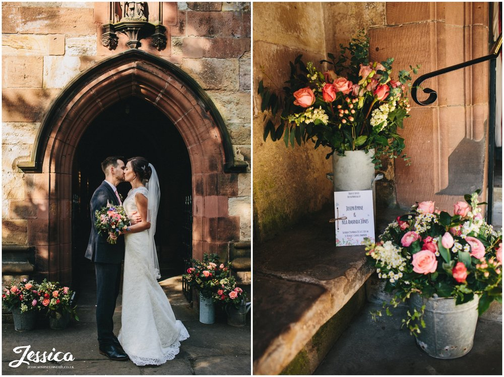 bride & groom kiss outside the church surrounded by rustic flowers