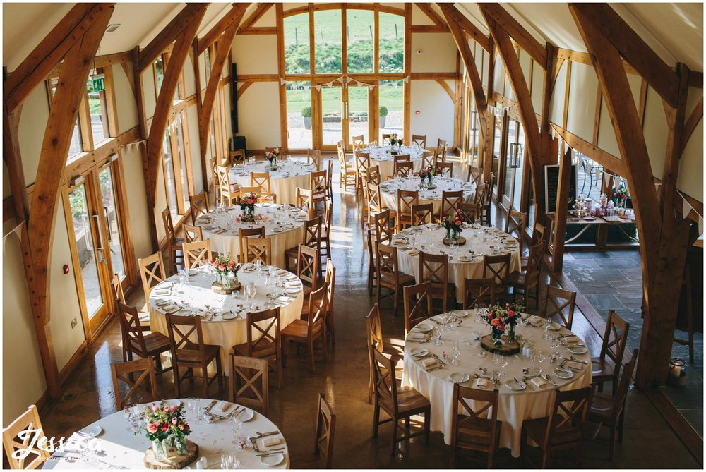 aerial shot of the tower hill barns room laid up for wedding breakfast