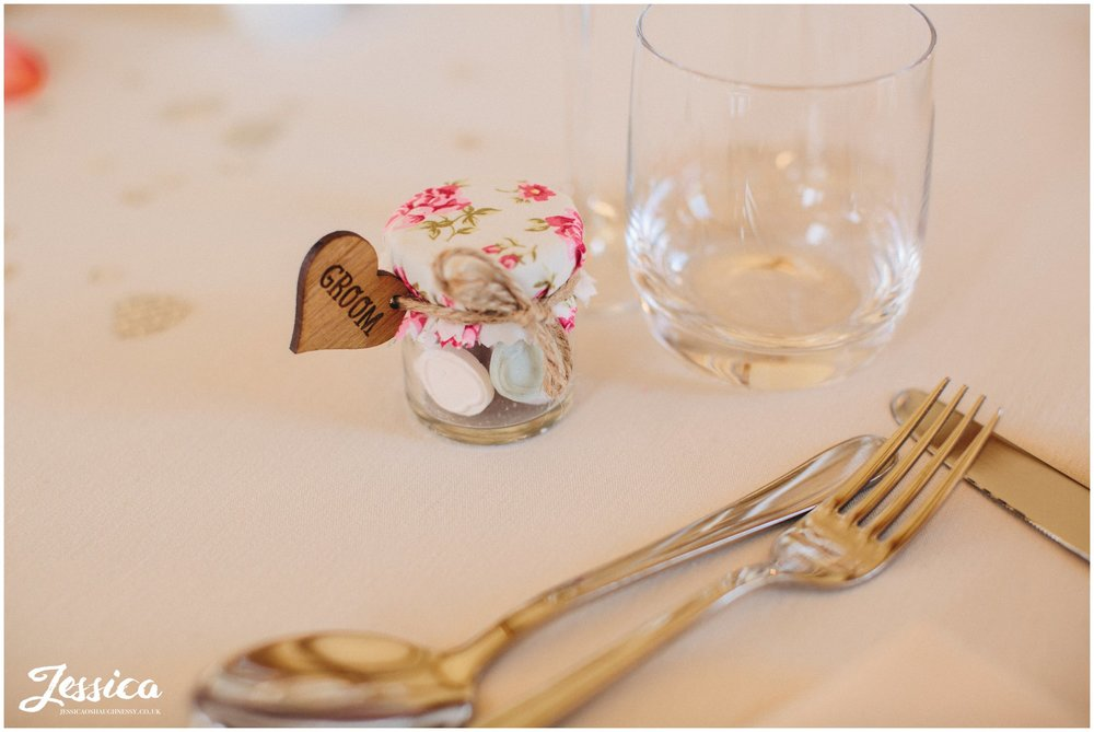 close up of groom's wooden heart place name at a north wales wedding
