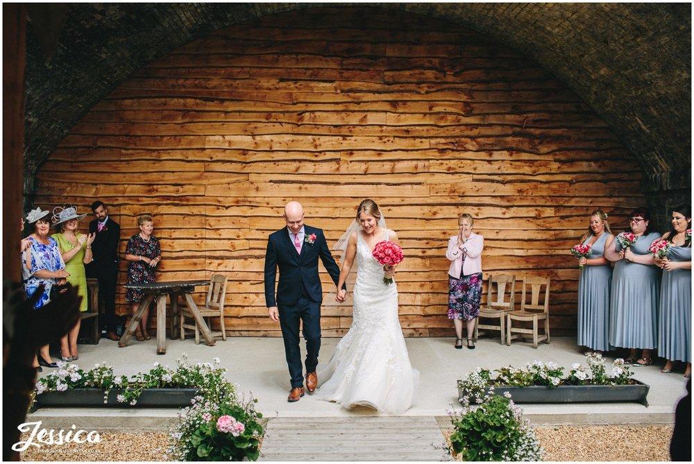 bride & groom exit their wedding ceremony under the bridge - wrexham, north wales