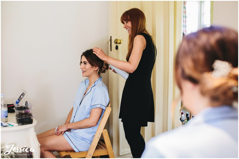 bridesmaid getting her hair done at Combermere Abbey in whitchurch