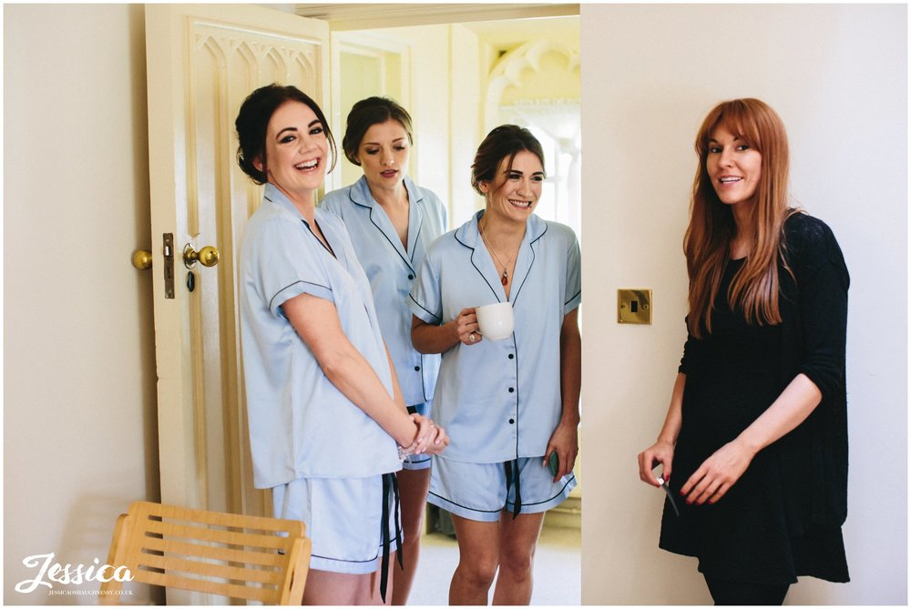 bridesmaids laugh on the morning of the wedding