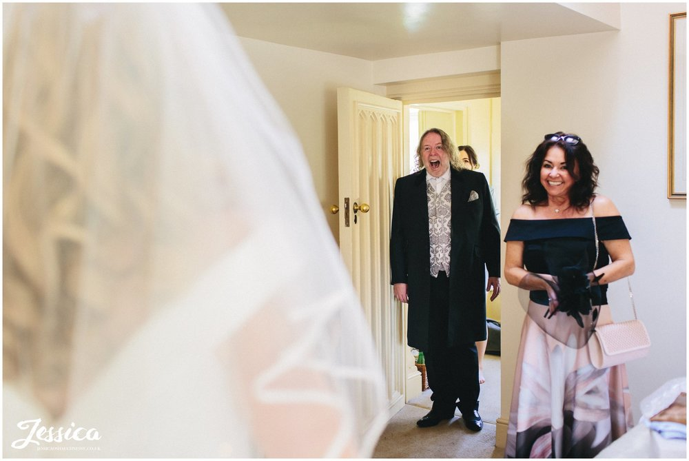 father of the bride see's his daughter for the first time on her wedding day