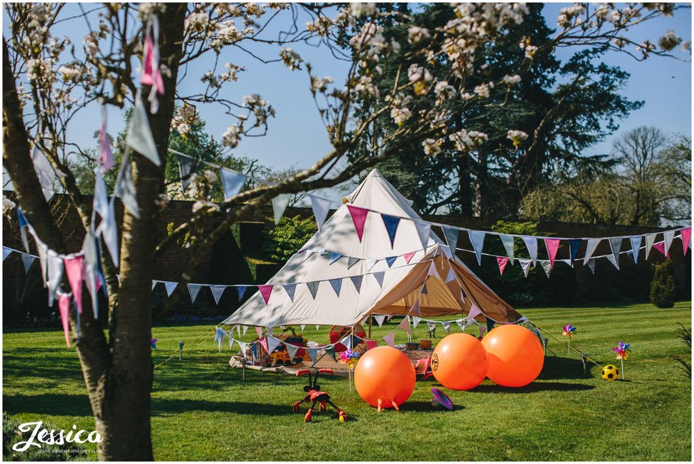 children's play tipi in the grounds at a Combermere Abbey wedding, whitchurch