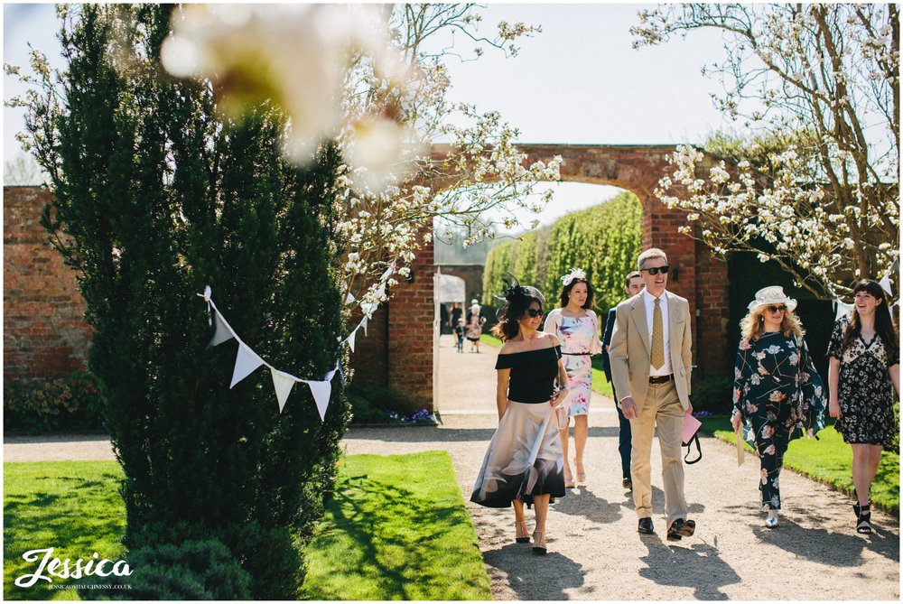 guests arriving at Combermere Abbey for the wedding ceremony